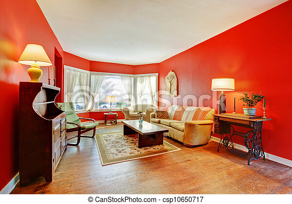 Large red living room with hardwood and antique furniture. - csp10650717
