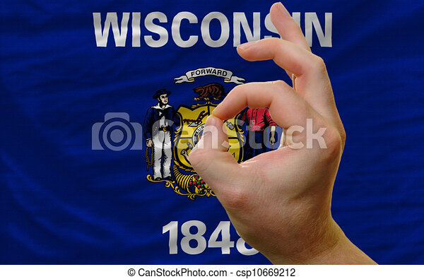 ok gesture in front of wisconsin us state flag - csp10669212