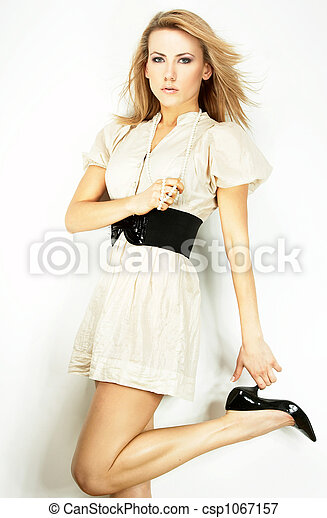 Fashion model Posed on light background - csp1067157