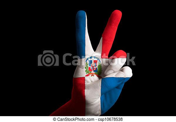Hand with two finger up gesture in colored dominican national flag as