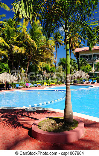 Swimming pool hotel at tropical resort - csp1067964