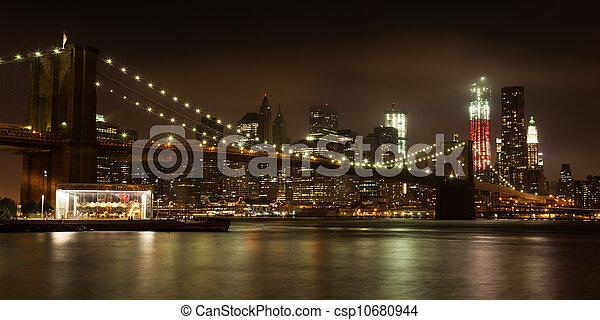 Panoranic view  of  Manhattan skyline by night from Brooklyn bridge park - USA - csp10680944