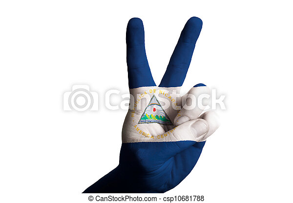 Hand with two finger up gesture in colored nicaragua national flag as