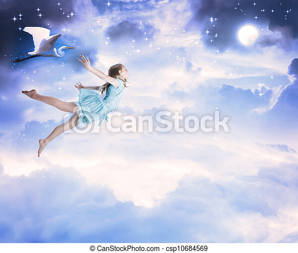 Little girl flying into the blue night sky - csp10684569