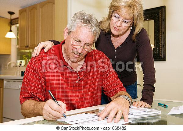Mature Couple - Signing Paperwork - csp1068482
