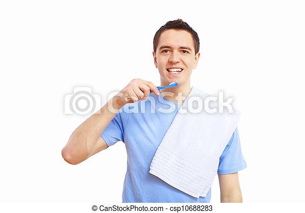 Young man at home brushing teeth - csp10688283