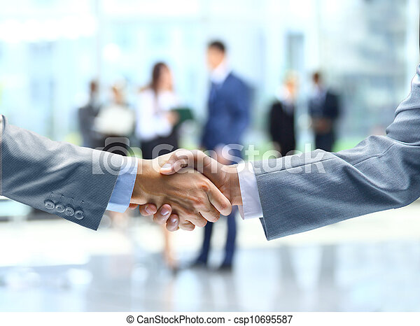 Business handshake and business people - csp10695587