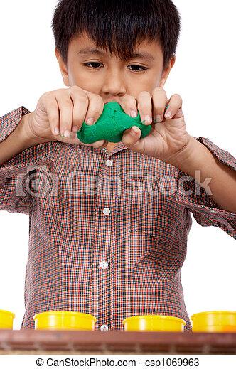 kid playing dough - csp1069963