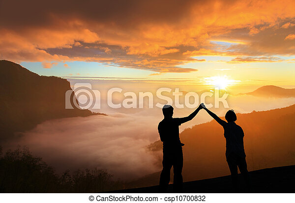 silhouette of Young family happy look sunrise - csp10700832