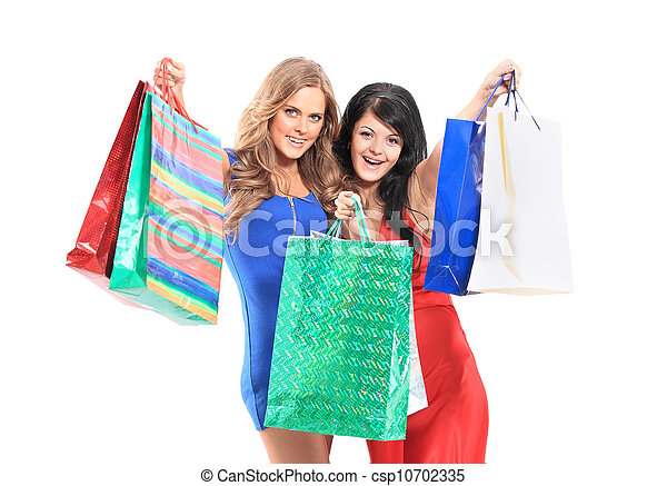 group of two happy young adult women out of shopping with colored bags - csp10702335