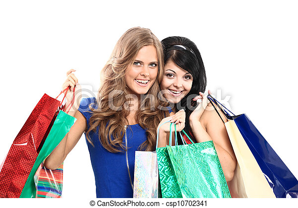 group of two happy young adult women out of shopping with colored bags - csp10702341