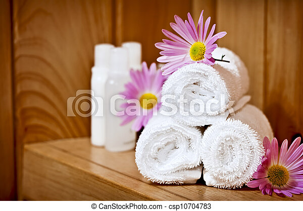 White rolled up spa towels - csp10704783