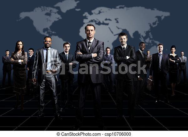 business team formed of young businessmen standing over a dark background - csp10706000