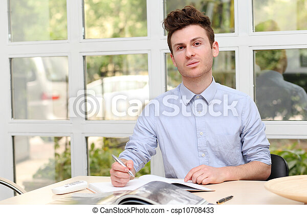 Young adult man writing note - csp10708433