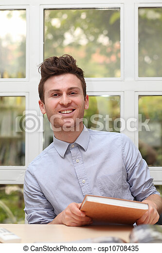 Young adult man with note book - csp10708435