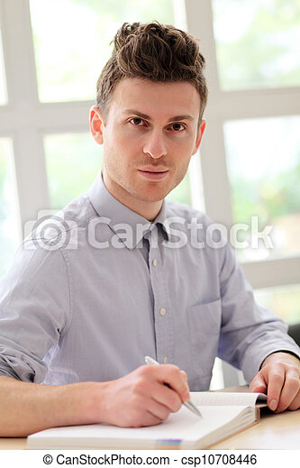 Young adult man writing note - csp10708446