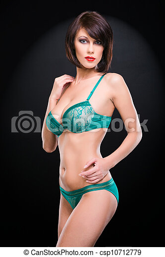 image de jeune femme l gant vert dentelle sous v tements csp10712779 recherchez des. Black Bedroom Furniture Sets. Home Design Ideas