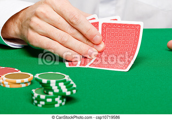 Man with cards on a gambling table - csp10719586