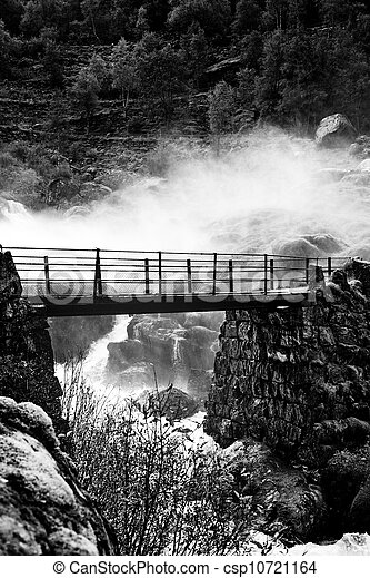 Bridge over waterfall - csp10721164