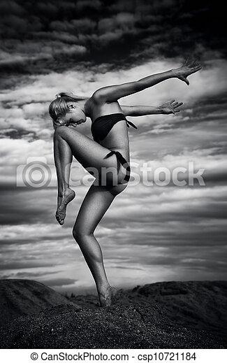 Young slim woman dancing - csp10721184