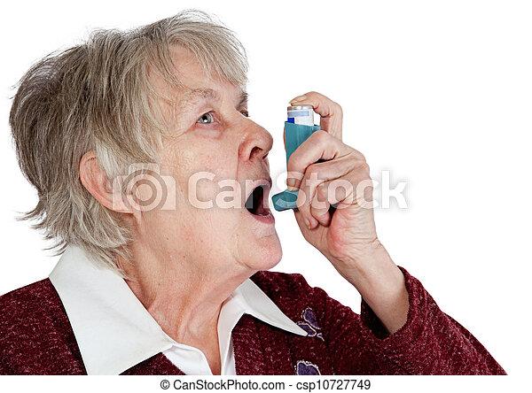 Senior woman with asthma inhaler - csp10727749