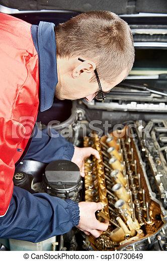 machanic repairman at automobile car engine repair - csp10730649