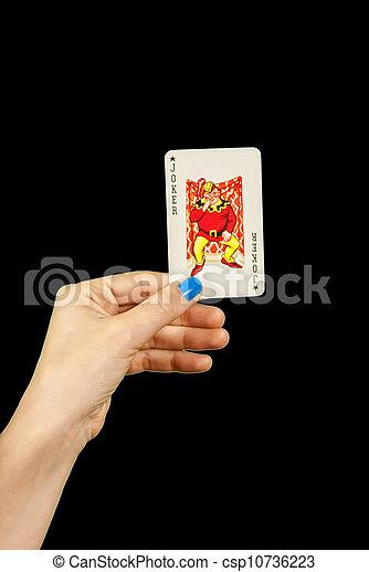 Hand holding joker