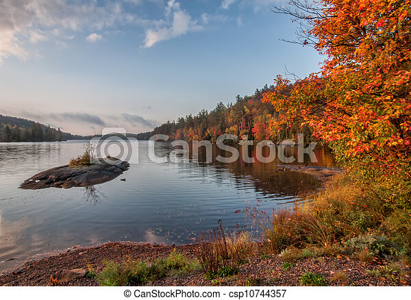 Lake With Small Island During Fall - csp10744357