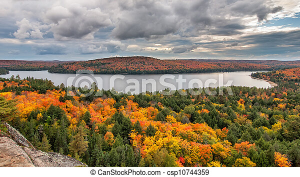 View Overlooking Lake and Changing Fall Trees - csp10744359