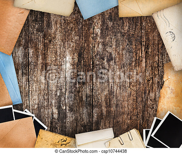 Frame with old paper and instant photos. Objects over old wood background - csp10744438