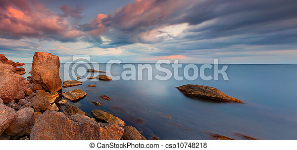 Colorful panorama of the sunset on the sea - csp10748218