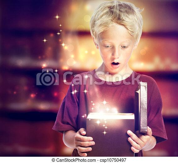 Happy Boy Opening a Gift Box - csp10750497