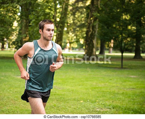 Jogging - man running in nature - csp10766585