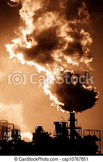 Smoking chimney  at sunset  - csp10767851