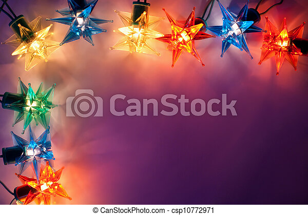 Christmas lights frame on dark background with copy space.Decorative garland  - csp10772971
