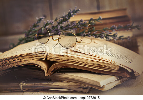 Old books open on wooden table - csp10773915
