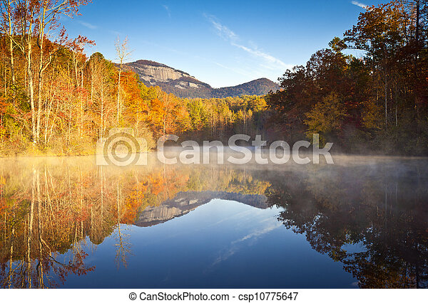 South Carolina Autumn Sunrise Landscape Table Rock Fall Foliage Reflections fog covered lake - csp10775647
