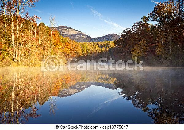 South Carolina Autumn Sunrise Landscape Table Rock Fall Foliage Reflections fog covered lake - csp10775647