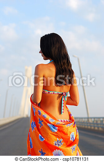 Young adult walking over  bridge - csp10781131