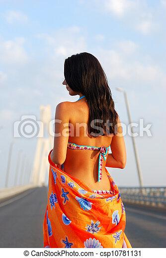 Young adult walking over  bridge - csp10781131