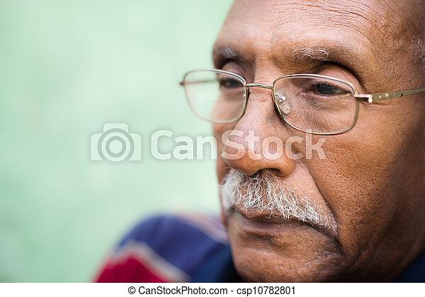 Worried senior african american man with eyeglasses - csp10782801