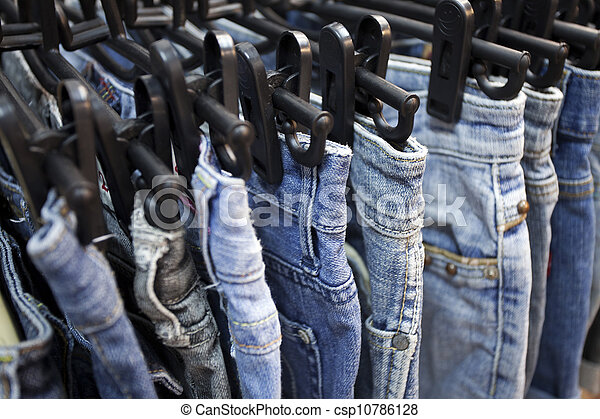 Jeans and trousers on hangers - csp10786128