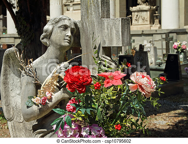 angel holding flowers on cmetery - csp10795602