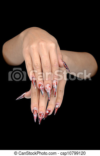 Closeup of hand of young woman long nail-art manicure on nails - csp10799120