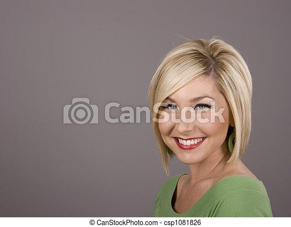 Blonde in Green Dazzling Smile - csp1081826