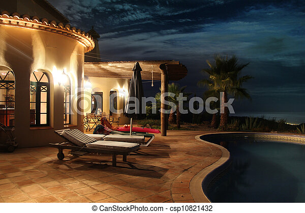 Facade with lights and pool - csp10821432