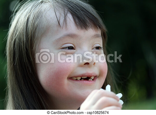 Portrait of beautiful young girl with flowers in the park - csp10825674