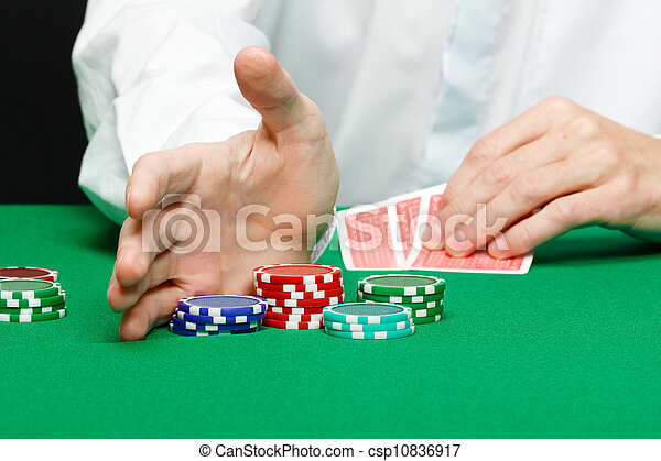 Man with cards on a gambling table - csp10836917