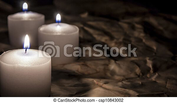white candles on dark paper background, religion concept - csp10843002