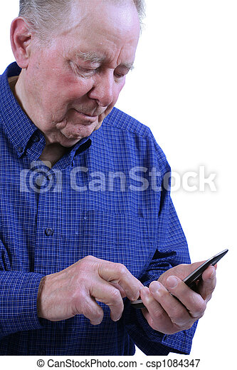 Elderly man dialing cell phone - csp1084347